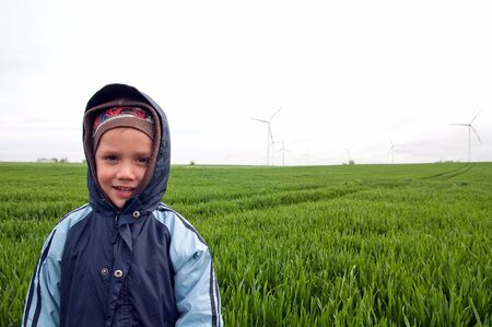 the boy on wind farm photo
