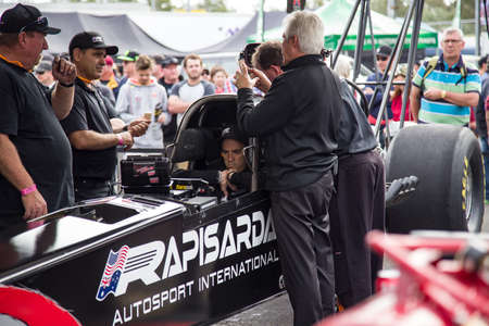 Ipswich, Queensland, Australia. July 8, 2018. Larry Dixon and Lee Beard preparing a top fuel dragster for a race.