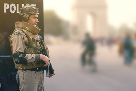 police unit: Member of the Delhi Police Commando counter terrorism unit, standing at the ready near the India gate. Editorial