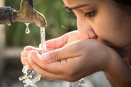 clean up: Women drinking tap water in outdoor.