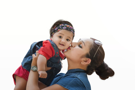 Mother holding her cute daughter isolated on white background Stock Photo