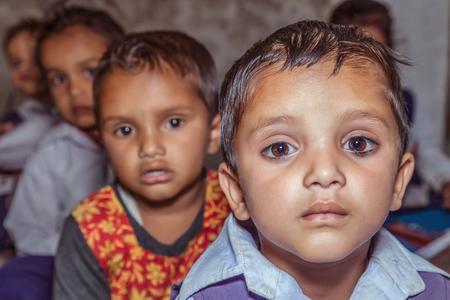 Portrait of Indian rural pre school girls in classroom at village school.