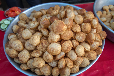 Famous Indian street food gol gappe or pani puri. Chat item Selling in Indian market