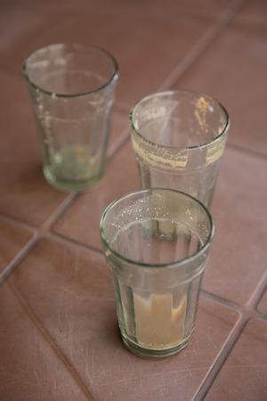 Three empty tea glasses on plastic table Archivio Fotografico