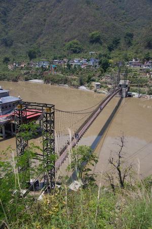 Suspension bridge in the middle of Alaknanda river near Srinagar adjoining the famous Dhari Devi temple ,Uttarakhand, India