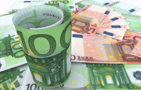 Hundred Euro bills on top of money pile. High resolution, sharp 3D rendering.
