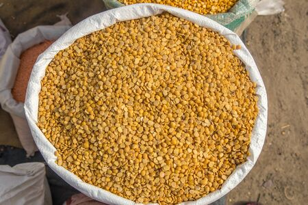 Burlap, Bag full of Arhar or masoor Dhal or Toor Dal Pigeon Pea. concept for earnings or spend in Agriculture. Stock Photo