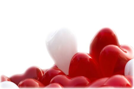 Red and White heart shape baloons over white background, writing space