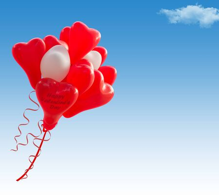 Red and White heart shape baloons flying in the sky, writing space