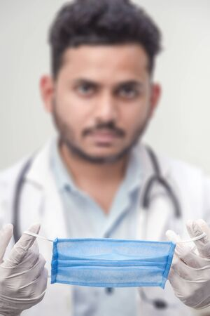 Covid-19 Coronavirus - Doctor with Surgical Mask for protect and to stop corona virus outbreak.