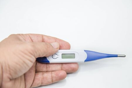 Novel coronavirus COVID-19 - hand holding thermometer on white back ground. High temperature, symptoms of a virus or illness. Chinese coronavirus outbreak, Middle East respiratory syndrome coronavirus.