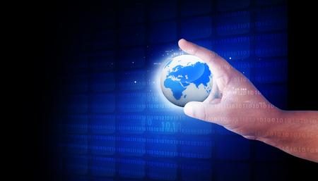Human hand holding the digital world photo