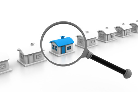 House and magnifying glass. House search concept. photo