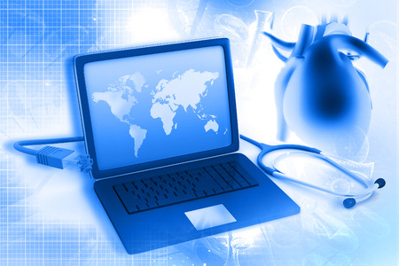 Laptop and stethoscope with human heart   photo