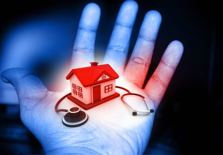 remediation: House and stethoscope in human hand