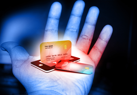 smart card: Mobile smart phone with credit card in human hand