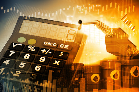 oil drum: Oil price graph, oil pump nozzle and stock market  chart Stock Photo