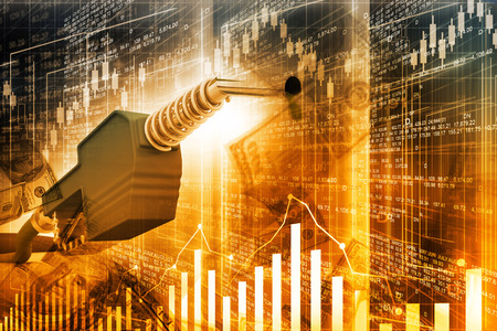 petroleum: Oil price graph, oil pump nozzle and stock market  chart Stock Photo