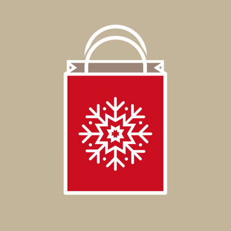 holiday shopping: Silhouette of a Christmas holiday gift bag with snowflake ornament decoration on light beige background.