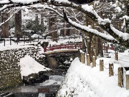 snowing river photo