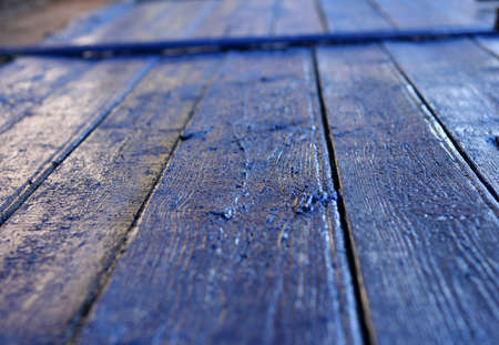 navy blue wooden surface soft focus photo
