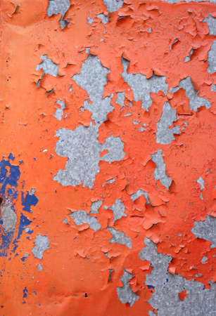 flaking: flaking old orange paint on a stainless steel surface Stock Photo