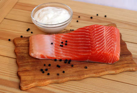 salmon fillet with pepper on a table photo