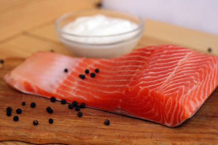salmon steak with pepper on a table photo