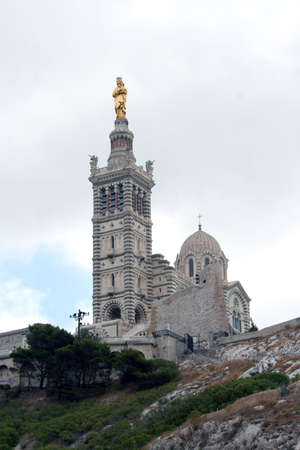 garde: Notre-Dame de la Garde  Our Lady of the Guard , a basilica in Marseille, France
