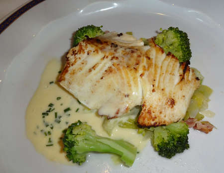 Grilled seabass with broccoli on a plate photo