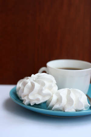 whithe: whithe homemade merengues with cup of coffee