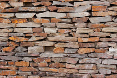 tiling: tiling stone wall. Sand stone. Stock Photo
