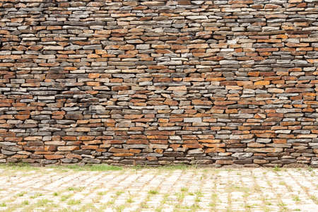 tiling: tiling stone wall. Sand stone and grass Stock Photo