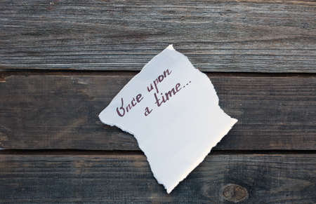 phrase novel: once upon a time hand written on piece of paper Stock Photo