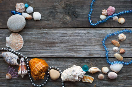 corall: seashells and pebbles on the wooden rustic table