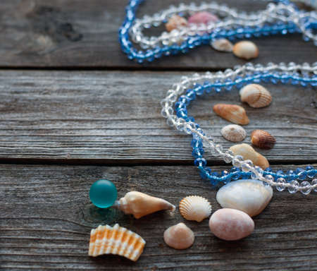 corall: seashells and pebbles on the wooden rustic table, soft focus Stock Photo