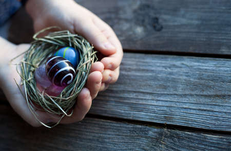 easter decoration - easter glass eggs in hands photo