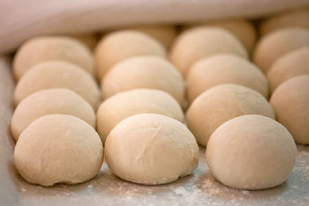 fermentation: Raw pieces of bread dough before fermentation and baking process Stock Photo