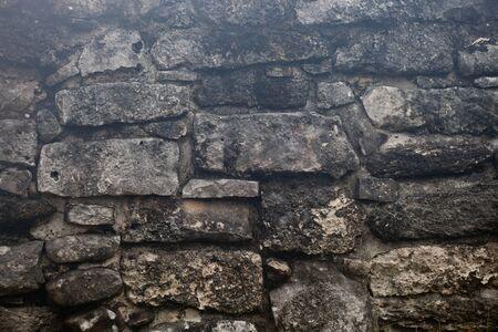 Raue verwitterte alte Maya-Steinwand-Oberflächenstruktur