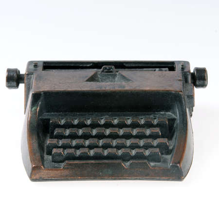 typewriter machine: Miniature toy typewriter machine isolated on white. Stock Photo