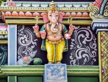 Ganesha God Statue on Hindu Temple                          photo
