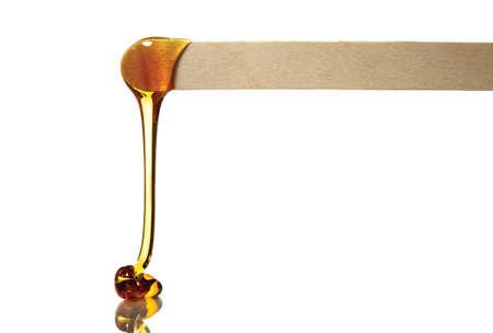 depilaciones: De alta resoluci�n de cera dejar esp�tula de madera con fondo blanco