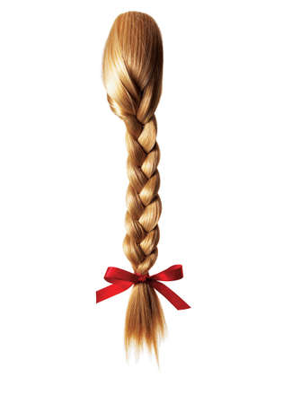 uncombed: blond braid of girls hair Stock Photo