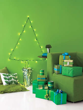 artificial lights: christmas tree made of string lights and presents, winter holidays Stock Photo
