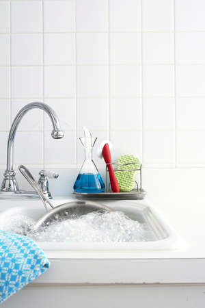 wash dishes: indoor setting, kitchen sink