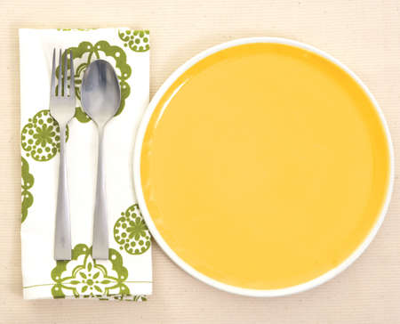 Served place setting: empty dinner plate and silverware photo