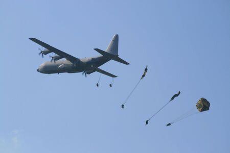 parachutists: Parachutist dropping Stock Photo