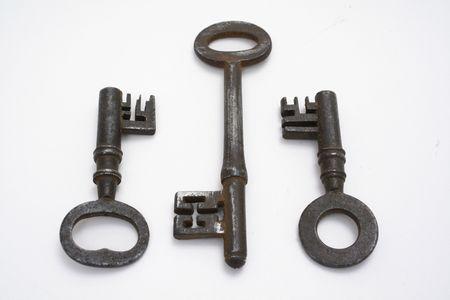 Three old vintage keys on white backgtound.