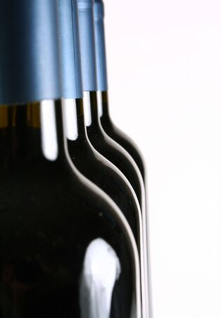 Four wine bottles with white background.