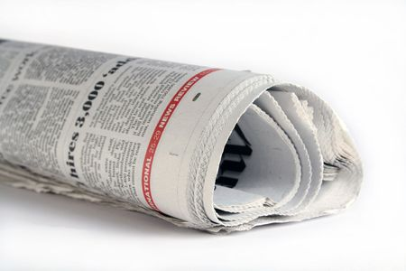 Rolled up newspaper Stockfoto